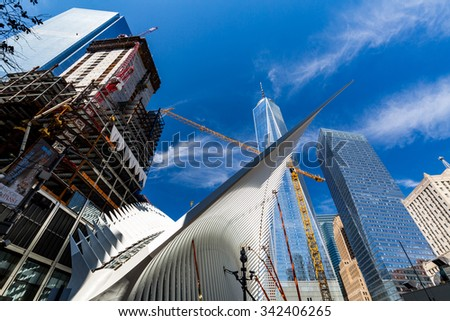 NEW YORK - AUGUST 22: Views to the World Trade Center and Ground Zero construction site in New York on August 22, 2015. Previous World Trade Center was destroyed in the September 11 attacks. - stock photo
