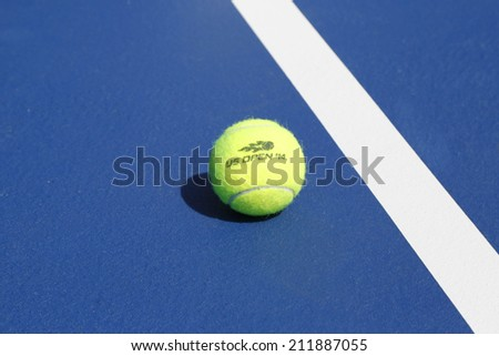NEW YORK - AUGUST 19: Wilson tennis ball on tennis court at Arthur Ashe Stadium on August 19, 2014 in New York. Wilson is the Official Ball of the US Open since 1979 - stock photo