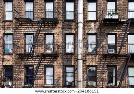 New York Brick Buildings With Outside Fire Escape Stairs USANew York Brick  Buildings Outside Fire Stock Photo 204186154