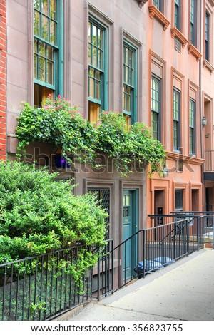 New York brownstone houses - old townhouses in Lenox Hill, Upper East Side neighborhood in Manhattan. - stock photo