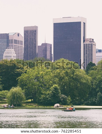 New york buildings and Central park glimpse seen from the river
