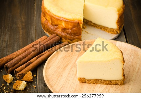 New York cheesecake on wooden background - stock photo