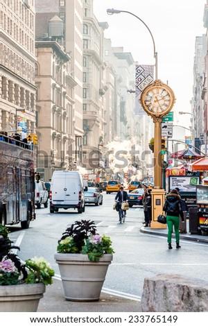 New York circa dec 2011: People walk near historical flat iron vintage building in Manhattan - stock photo
