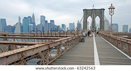 NEW YORK - CIRCA JULY 2009: The Brooklyn bridge circa July 2009 in New York City. The Brooklyn Bridge is one of the oldest suspension bridges in the United States. - stock photo