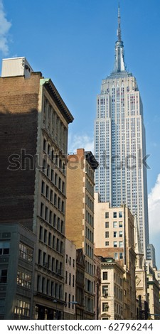 NEW YORK - CIRCA JULY 2009: The Empire State Building circa July 2009 in New York City. After the terrorist attack on 9/11/01, this is the tallest building in New York and 3rd in USA. - stock photo