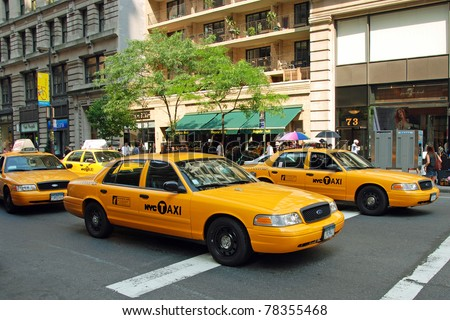NEW YORK - CIRCA JULY 2009: The New York City Taxi circa July 2009 in New York City. Taxicabs with their distinctive yellow paint, are a widely recognized icon of the city. - stock photo