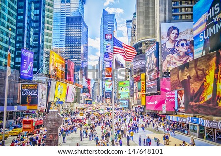 "NEW YORK - CIRCA MAY 2013: Times Square, New York, circa May 2013. It's a major commercial intersection, iconified as ""The Crossroads of the World"", it's also the hub of the Broadway Theater District - stock photo"