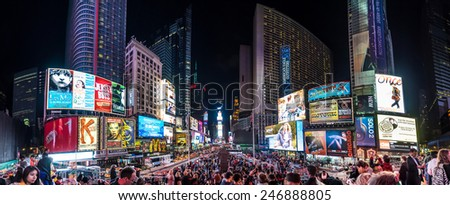 NEW YORK - CIRCA OCT, 2014: Night traffic across Times square in New York City in a panoramic 180° view. Times Square is the most visited tourist attraction in the world.
