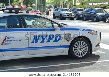 NEW YORK - CIRCA SEPTEMBER 2015. A hybrid NYPD patrol car on street, evidencing an increase in use of vehicles that make use of alternative fuels with the aim to help curb pollution in Manhattan.