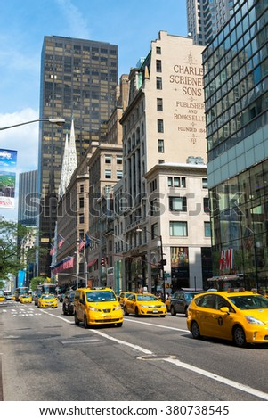 NEW YORK - CIRCA SEPTEMBER 2015: Throng of Yellow Taxi Cabs Stopped at Red Light at Intersection on Busy Street in Manhattan, New York City, New York, USA - stock photo
