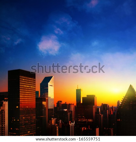 New York City and colorful sunrise. - stock photo