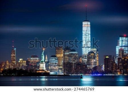 New York City and its three iconic landmarks: Statue of Liberty, Freedom Tower and Empire State Building in a single real image. - stock photo