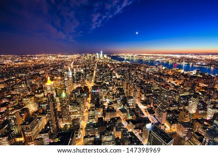 New York City and New Jersey skyline at night w the Freedom tower and Brooklyn bridge - stock photo