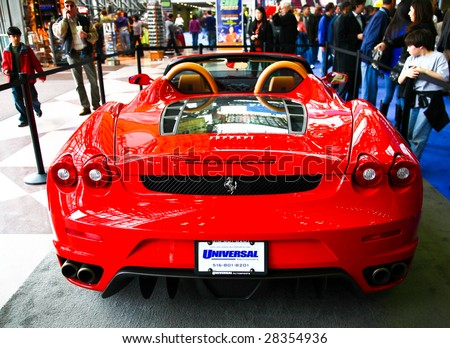 NEW YORK CITY - APR 10: A Ferrari car model on display at the opening day of NY International Auto Show 2009 April 10, 2009 in New York. The auto industry is struggling in the current economic crisis. - stock photo