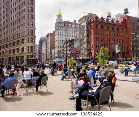 NEW YORK CITY - APR 20:  The public plaza outside the Landmark Flatiron Building in NYC on Apr. 20 2012.  This 50,000 sq. foot pedestrian plaza is located on Broadway. - stock photo