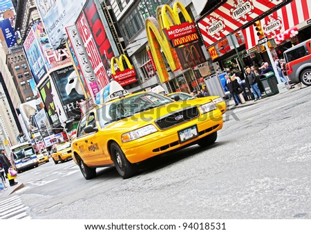 NEW YORK CITY - APR 18: Times Square, famous tourist attraction featured with Broadway Theaters and famous restaurant and store locations in New York City, April 18, 2011 in Manhattan, New York City. - stock photo