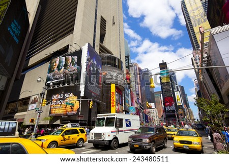 NEW YORK CITY - APR 27: Times Square with busy traffic and yellow taxi in Midtown Manhattan on April 27, 2012, New York City. - stock photo
