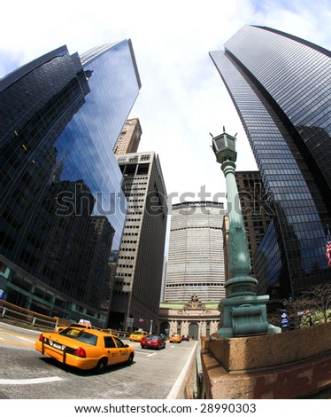 NEW YORK CITY- APRIL 17 : A fisheye view of skyscrapers on famous Park Avenue near grand central station April 17, 2009 in New York. - stock photo