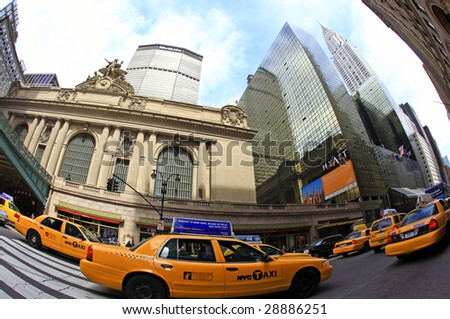 NEW YORK CITY- APRIL 17 : A fisheye view of yellow taxies jam rushing in front of the grand central station during the Friday afternoon rush hour April 17, 2009 in New York.