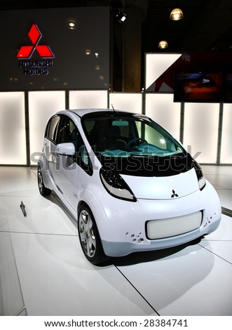 NEW YORK CITY - APRIL 10 : A Mitsubishi iMiEV car model on display at NY International Auto Show 2009 April 10, 2009 in New York.  The auto industry is struggling in the current economic crisis. - stock photo