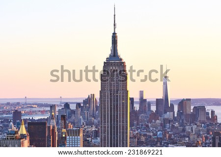 NEW YORK CITY - APRIL 01: Cityscape view of Manhattan with Empire State Building, New York City, USA at sunset on April 01, 2014.  - stock photo
