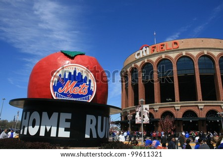 NEW YORK CITY - APRIL 8: Crowd arriving at Citi Field for a Major League Baseball game between the New York Mets and Atlanta Braves on April 8th, 2012 in Queens, New York. - stock photo