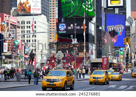 NEW YORK CITY -APRIL 30: Crowds in Times Square in sunny day with busy traffic and commercial atmosphere on April 30, 2012 in New York, NY, US. - stock photo