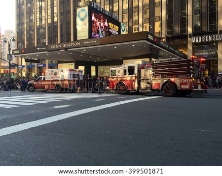 New York City - April 1, 2016: FDNY fire engine and ambulance sit outside Penn Station responding to an emergency.