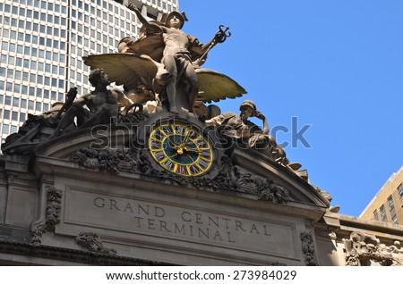 New York City - April 29, 2015: Grand Central Terminal Clock, NYC, USA. Building facade decoration and clock from a street view.  - stock photo