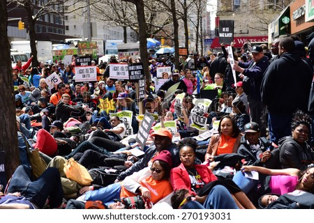 NEW YORK CITY - APRIL 15 2015: high school students, union activists & fast food workers marched in Manhattan's Upper West Side to demand a $15 per hour federal minimum wage.