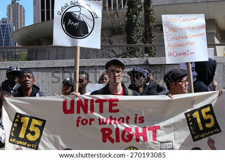 NEW YORK CITY - APRIL 15 2015: high school students, union activists & fast food workers marched in Manhattan's Upper West Side to demand a $15 per hour federal minimum wage. - stock photo