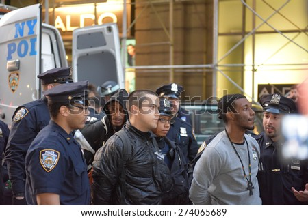 NEW YORK CITY - APRIL 29 2015: hundreds of demonstrators filled Union Square in support of Freddie Gray protests in Baltimore. Attempts to march resulted in more than one hundred arrests by NYPD - stock photo