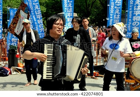 New York City - April 30, 2010:    Japanese musicians from UTAGOE singing at Columbus Circle during a demonstration for a nuclear weapons free world - stock photo