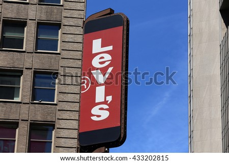 "NEW YORK CITY - APRIL 26, 2015: Logo of famous brand ""Levi's"" in Time's Square, NYC. Levis is a privately held American clothing company known worldwide for its Levi's brand of denim jeans. - stock photo"