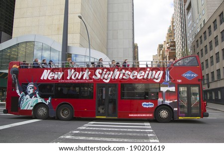 NEW YORK CITY- APRIL 27: New York Sightseeing Hop on Hop off bus in Manhattan on April 27, 2014. Since 1926, Gray Line New York is the source for best double decker bus and deluxe motor coach tours - stock photo
