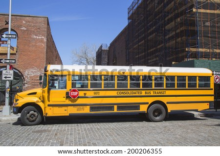 NEW YORK CITY- APRIL 24: School bus in Brooklyn on April 24, 2014. NYC has the largest school transportation department in the country - stock photo