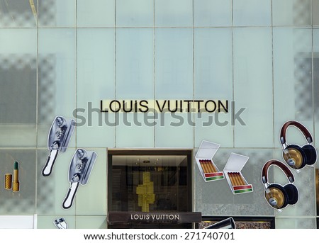 NEW YORK CITY - APRIL 19: Shopping on 5th Avenue in NYC. Louis Vuitton a French fashion house founded in 1854 by Louis Vuitton as seen in New York City on April 19, 2015 - stock photo