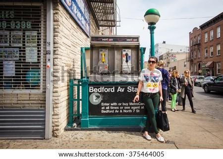 NEW YORK CITY - APRIL 28, 2013: Street corner scene from Williamsburg Brooklyn, New York City with Bedford Avenue subway entrance seen. - stock photo