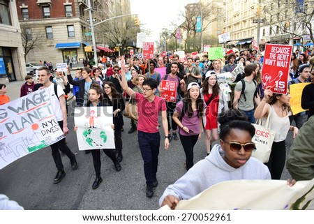 NEW YORK CITY - APRIL 15 2015: students, adjuncts & organized labor activists gathered at Columbia University for a rally & march to an UWS McDonald's demanding $15 per hour federal minimum wage - stock photo
