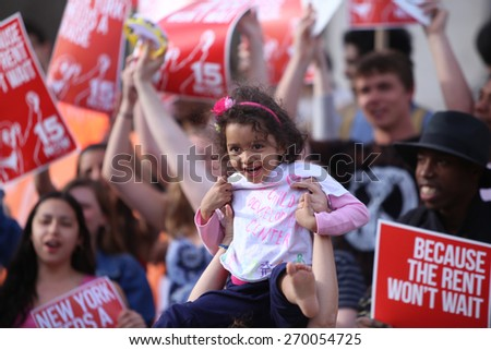 NEW YORK CITY - APRIL 15 2015: students, adjuncts & union representatives gathered at Columbia University for a rally & march to an UWS McDonald's demanding a $15 per hour federal minimum wage. - stock photo