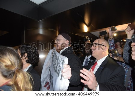 NEW YORK CITY - APRIL 14 2016: The New York state Republican party held a gala in honor of New Mexico governor Susana Martinez. Activists protest inside hotel prior to event - stock photo