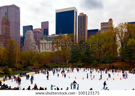 NEW YORK CITY-APRIL 1: The Trump Wollman Ice Rink in Central Park drew a big crowd today for its last day of the season in New York City on April 1, 2012.  The rink will reopen in October. - stock photo
