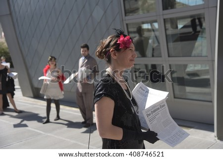 NEW YORK CITY - APRIL 19 2016: Volunteers in Prohibition Era attire pass out Drug Alliance Forum literature calling for an end to narcotics prohibition to passersby in front of the UN building.