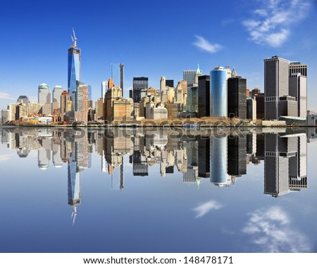 New York City at Lower Manhattan with reflections. - stock photo