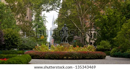 NEW YORK CITY - AUG 5: Gramercy Park is a small 2 acre park located in the Gramercy section of NYC on August 5, 2012. It is a private park with key access for residents that pay an annual fee to use. - stock photo