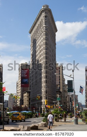 NEW YORK CITY - AUG 4: The Flat Iron building on August 4, 2011 in Manhattan, New York City. Completed in 1902, it is considered to be one of the first skyscrapers ever built. - stock photo