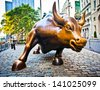 NEW YORK CITY - AUG 3: The landmark Charging Bull in Lower Manhattan represents aggressive financial optimism and prosperity  August 3, 2012 in New York, NY. - stock photo