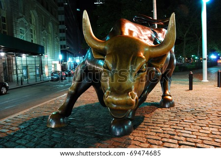 NEW YORK CITY - AUG 7: Wall Street Charging Bull, the symbol of aggressive financial optimism and prosperity and the famous landmark of Wall Street. August 7, 2010 in Manhattan, New York City. - stock photo