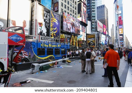 NEW YORK CITY - AUGUST 5 2014: a Gray Line double-decker tour bus collided with another tour bus in Times Square before smashing into a light pole on Duffy Square. 15 were injured; 3 seriously.