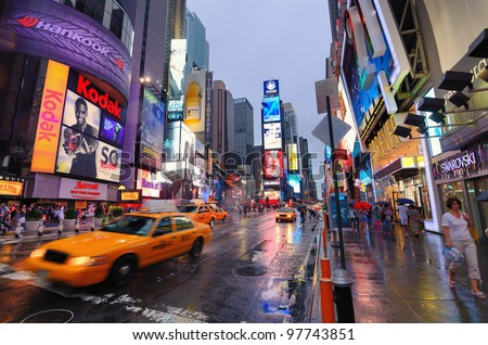 NEW YORK CITY - AUGUST 27: A wet Times Square August 27, 2011 in New York, NY.  Times Square is the world's most visited tourist attraction bringing over 39 million tourists annually. - stock photo